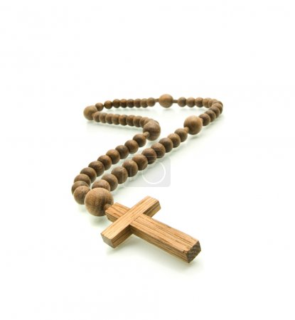 Wooden rosary beads on white