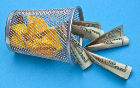 Photo for Trash Can with American Money Thrown Away on Blue Background. - Royalty Free Image