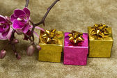 Gift boxes with purple orchid