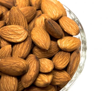 Many almonds nuts in glass bowl