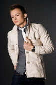 Attractive businessman in beige jacket