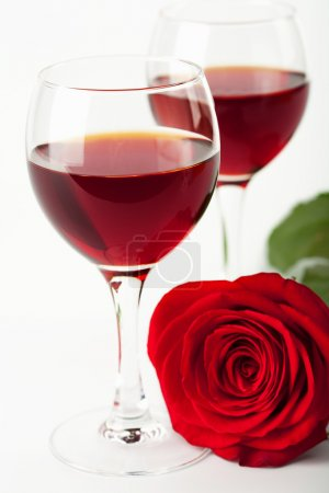 Wine glasses and red rose