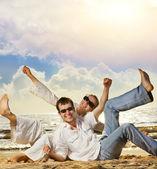 Young beautiful couple having fun on the beach