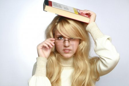Beautiful young woman wearing glasses