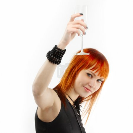 Beautiful red-haired girl lifts a toast