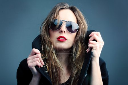 Photo for Rock'n'roll girl. Portrait of the girl in sun glasses - Royalty Free Image