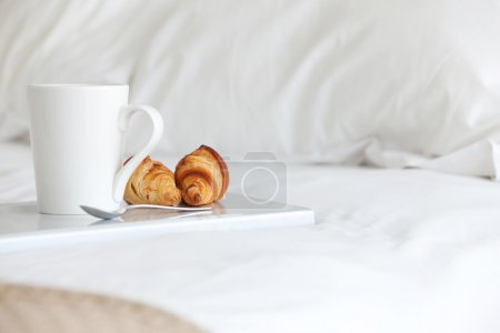 Photo for Tray with breakfast on a bed - Royalty Free Image