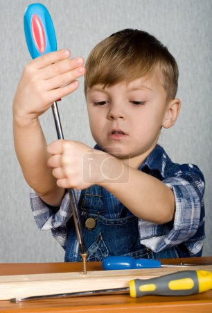 Boy as a construction worker, playing with tools...