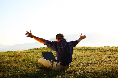 Photo for Man using a laptop outdoors with copyspace - Royalty Free Image