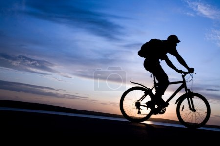 Silhouette of cyclists in motion