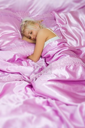 Young caucasian woman sleep in bed