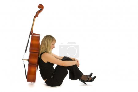 Photo for Sadness woman musician with cello on white background - Royalty Free Image