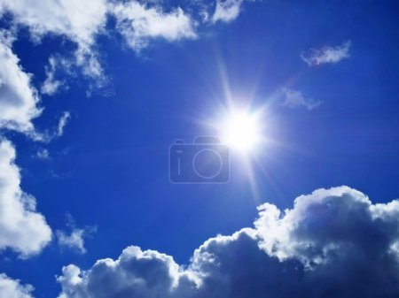 Photo for Deep blue sky with clouds and sunlight rays - Royalty Free Image