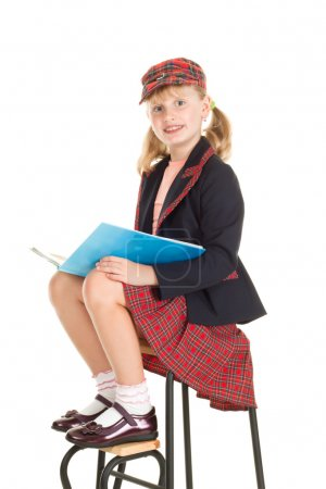 Teen girl in school uniform reading a book
