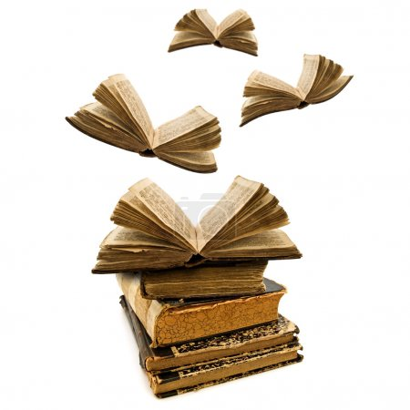 Photo for Education concept: opened old books flying away - Royalty Free Image
