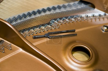Tuning fork on a piano