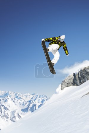 Snowboarder in the high mountains