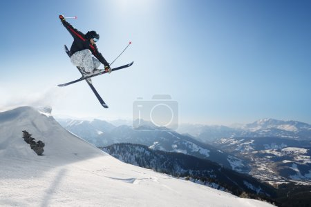 Photo for Jumping skier in the high mountains - Royalty Free Image