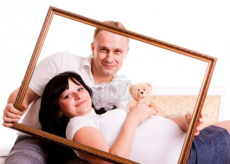 Beautiful young couple waiting to a baby