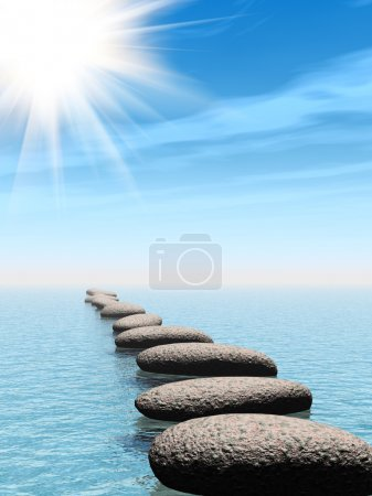 A row of stones in water with sun beam
