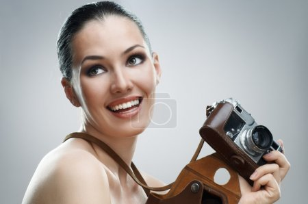 Photo for Girl photographer is waiting for the shot - Royalty Free Image
