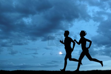 Photo for Woman and men running during sunset - Royalty Free Image