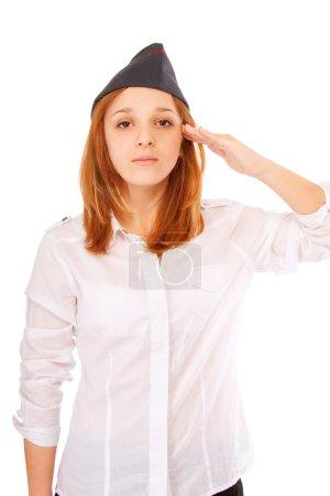 Photo pour Belle majorette en bonnet de champ pour rendre un salut, isolé sur fond blanc . - image libre de droit