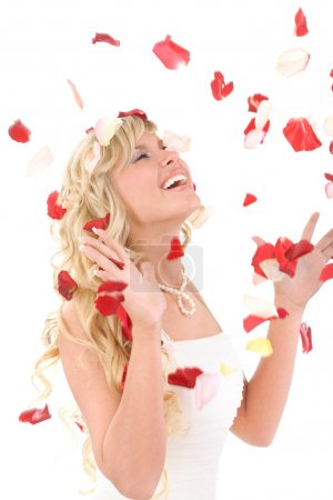 Beautiful laughing bride. On her petals of roses