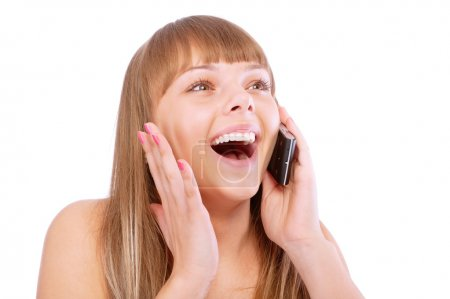 Beautiful girl speaks by phone and laughs