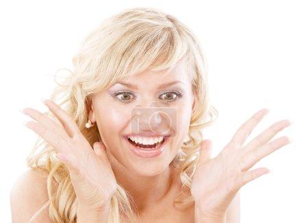 Photo pour Souriante blonde en admiration joyeuse, isolé sur fond blanc. - image libre de droit
