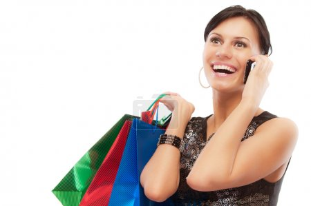 Charming girl with purchases speaks by phone