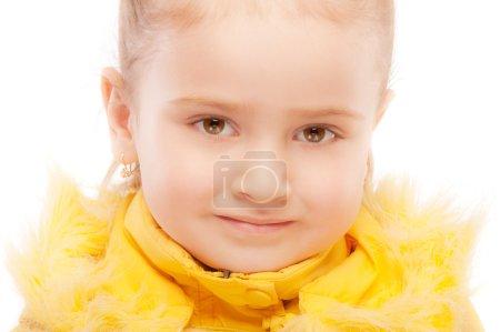 Portrait of beautiful preschool child in winter jacket