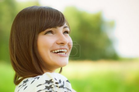 Photo for Portrait of beautiful girl against green summer nature - Royalty Free Image