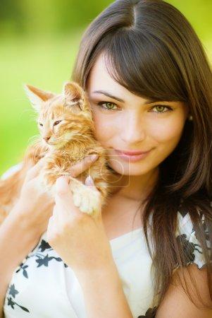 Beautiful girl with kitten