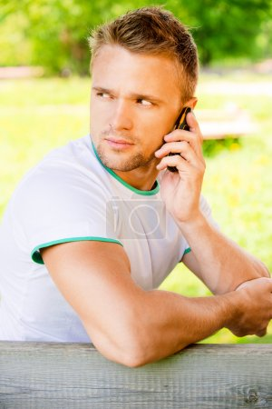 Young man speaks on phone