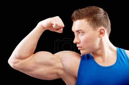 Powerful body builder shows biceps