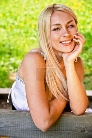 Girl sits on bench