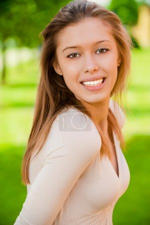 Photo for Portrait of smiling charming girl against summer green park. - Royalty Free Image