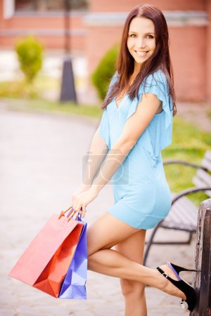 Woman with multi-colored packages
