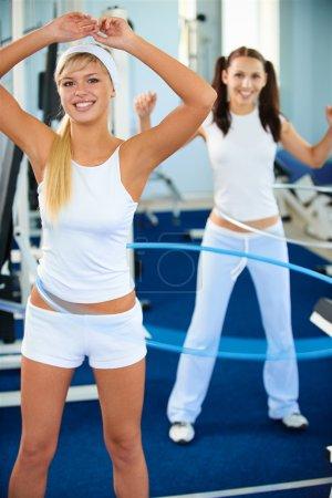 Girls with hula hoop