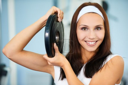 Photo for Portrait of sporty girl posing with single weight - Royalty Free Image