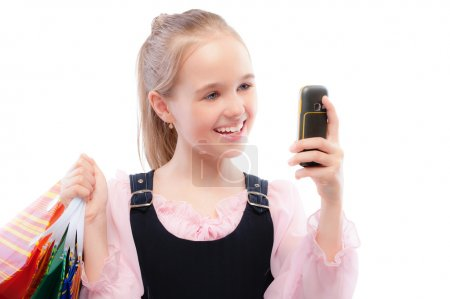 Young girl with purchases and phone