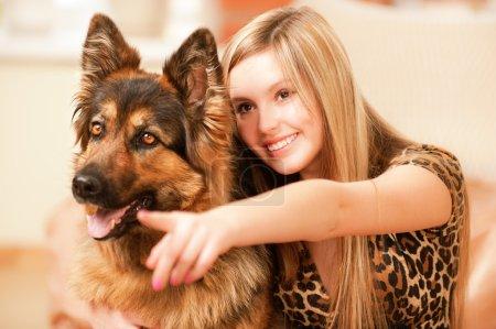 Beautiful woman and its sheep-dog