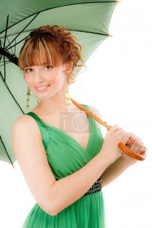 Charming young woman with green umbrella