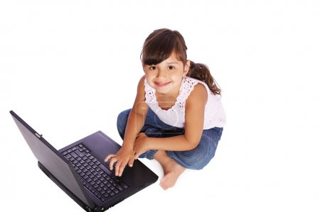 Kid girl with laptop