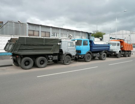 Grey, blue and orange trucks