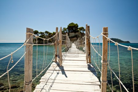 Wooden bridge with ropes over a sea in Zakhyntos