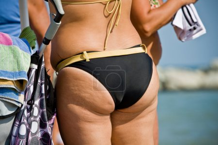 Photo for Adult women tushie with cellulite. Not everything is gold what shines. - Royalty Free Image