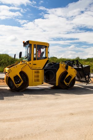 Heavy Vibration roller at asphalt pavement works (road repairing