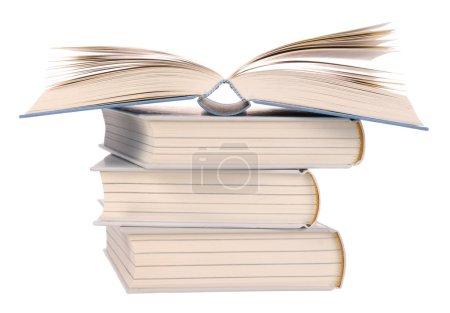 Photo pour Pile de livres avec un livre ouvert sur le dessus - image libre de droit